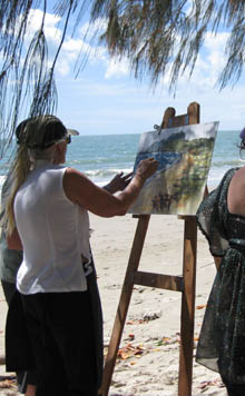 Chris with students painting on Four Mile Beach, Port Douglas