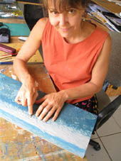 Artist, Anna Curtis, works on a lino block