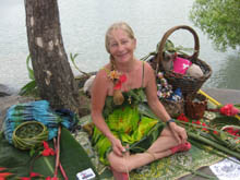 Gale sits near the ocean weaving baskets from coconut fronds