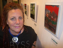 Cheryl with one of her abstract paintings