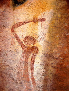 Mimi spirit figure on rock wall - red ochre colours