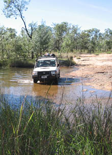 Four wheel drive crossing creek in Kimberley