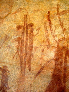 More mimi spirit figures in group painted in ochre on rock wall