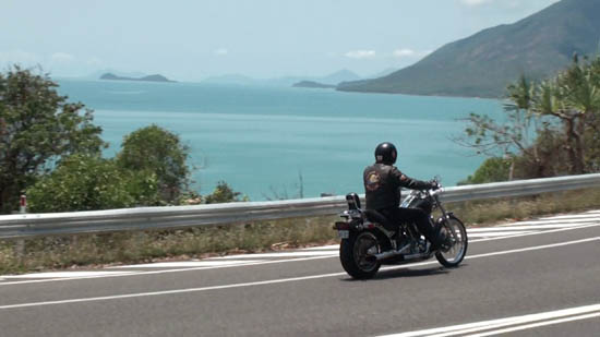 The coast road between Cairns and Port Douglas, Double Island in the distance.