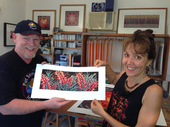 Graeme and Anna hold the reduction lino print that Anna finished during the filming session.