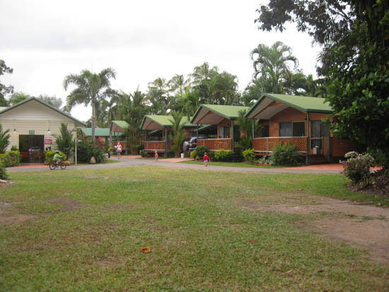 New, green roofed cabins in garden caravan park setting at Mission Beach North Queensland