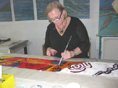 Marie paints on silk during silk painting workshop