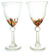 clear glass goblets with detail in stem, coloured pieces in lower part of glass