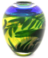 vase form with blue rim and green and yellow leaves