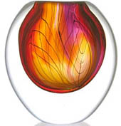 clear glass form with swirls of reds and oranges