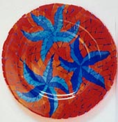 mosaic plate, red background dark blue flowers