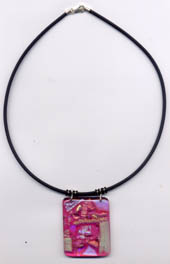 pink glass pendant on leather cord