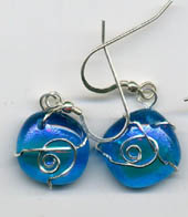 pair of transparent blue earrings, wrapped with silver wire