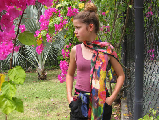 My grandaughter, Jasmin, models one of the scarves in the garden.
