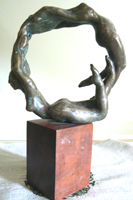 two bronze figures form a wheel