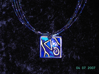 small square blue and gold painted coconut pendant