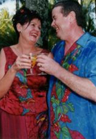 Couple wearing colourful Kathryn Edwards silk wedding outfits