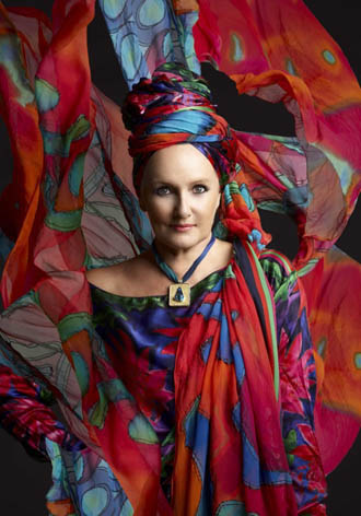 Linda draped in some of her opal scarves