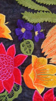 red and orange flowers on a navy background, banksia leaf  near the top