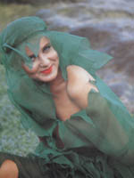 Linda in sheer green 'seaweed' outfit.