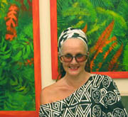 Linda Jackson and some of her tropical paintings