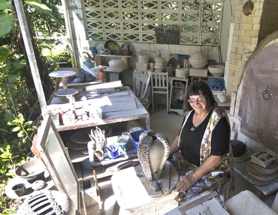 Lone works on a sculptural form in her Cairns studio