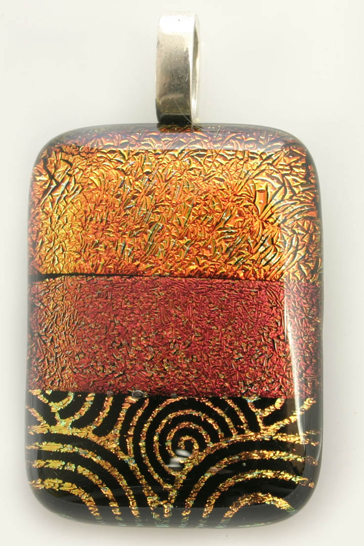 Hand made dichroic glass pendant in rusty colours by Marie Simberg-Hoglund