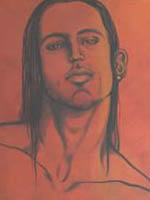 Portrait of young polynesian man with tattoos, straight black hair and smouldering eyes.