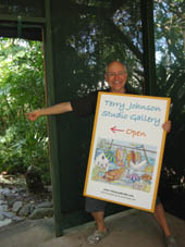 photo of Terry with 'studio open' sign near Terry's Port Douglas studio