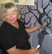Tania Heben working on her painting depicting Torres Strait pigeons.