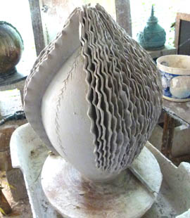 Hand built layer on top of wheel thrown form