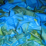 bright blues and green silk just dyed, crumpled, still wet
