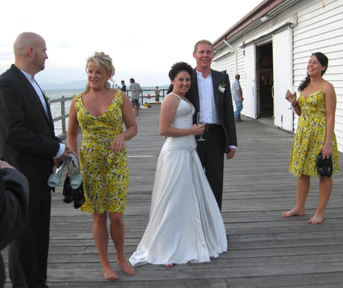The bridal party gather on the sugar wharf after the wedding.