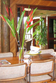 Dining rooom looking towards the verandah - cane chairs and timber table
