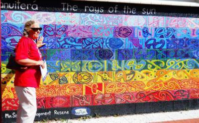 Shona Hammoind Boys with an Opotiki Youth Mural