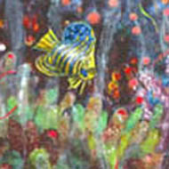 coral spawning with blue and yellow striped fish