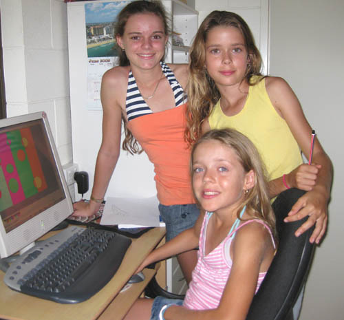 Lucinda, Jasmin and Olivia work on their computer designs.