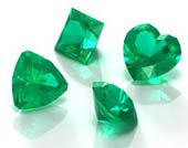 group of four cut emeralds, unset