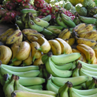 bananas and other fruit for sale at market stall
