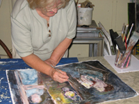 Helen Low works on her mixed-media painting