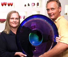 Marie and Ola Hoglund hold large blue glass platter
