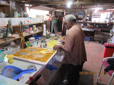 Paul working at Studio 8 Glass- panel