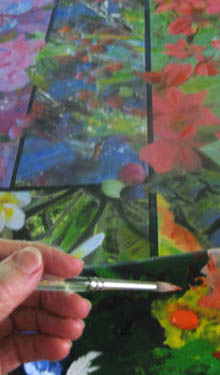 Hand painting oils over collaged images of tropical flowers.