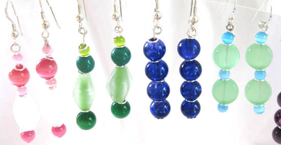 white and pink earrings with ones in greens, deep blues and pale greens, all with sterling silver rings and findings