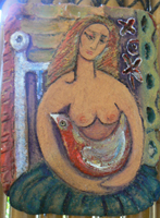 ceramic plaque depicts girl sitting, holding red bird.