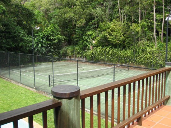 Tennis court set on edge of rainforest