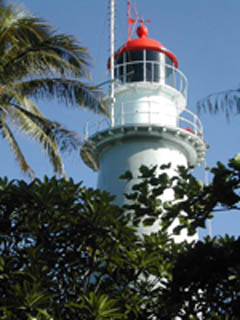 Low Isles lighthouse - white with red top
