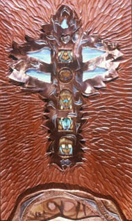 milky blue opal set in timber crucifixtimber