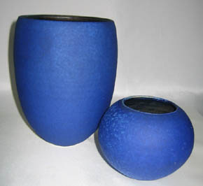 Two open round forms, blue matt glaze