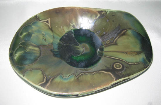 Plate showing green crystalline glaze